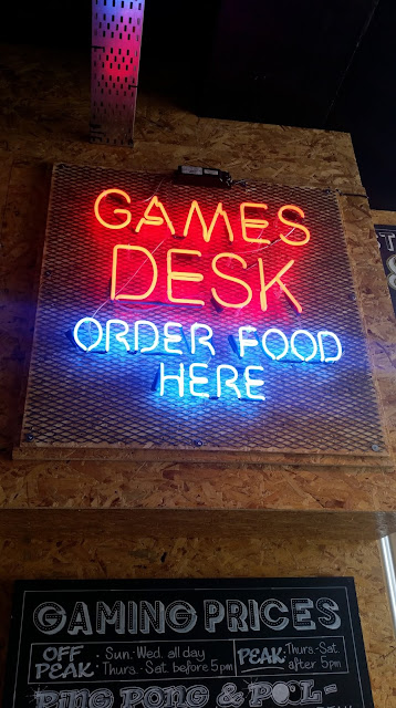 Neon Games Desk sign at Roxy Ballroom Liverpool