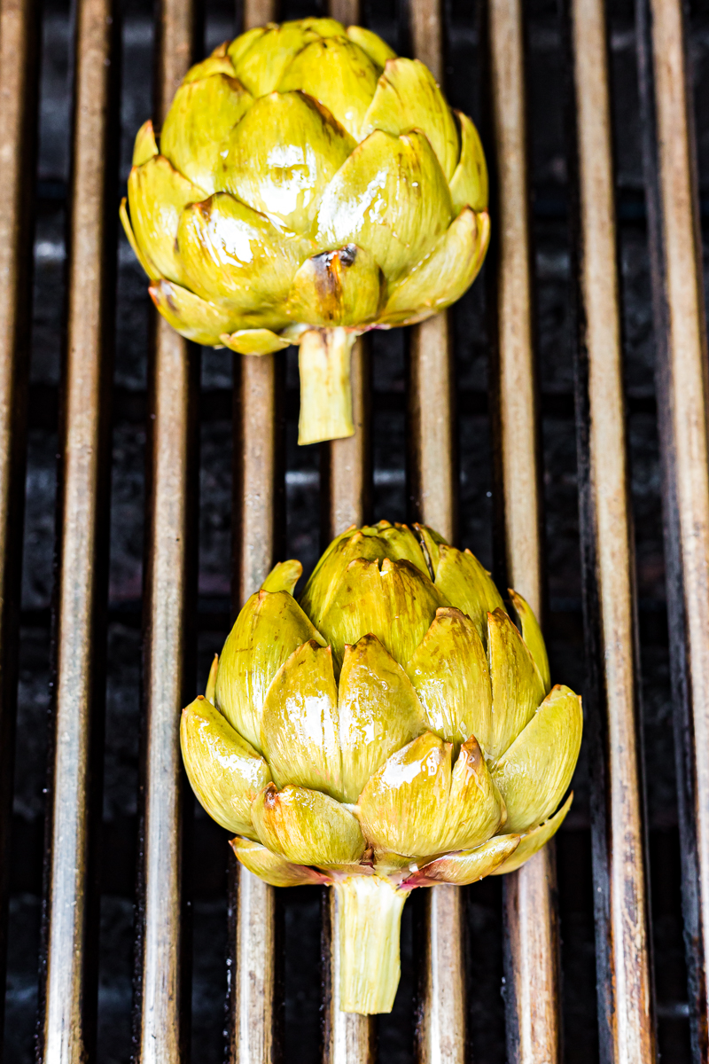 Grilled Artichokes with Lemon Garlic Sauce - Grilling makes everything taste better and these Grilled Artichokes with Lemon Garlic Sauce are proof of that! #grilled #bbq #artichokes #lemon #garlic #lowcarb #easy #sidedish #recipe | bobbiskozykitchen.com