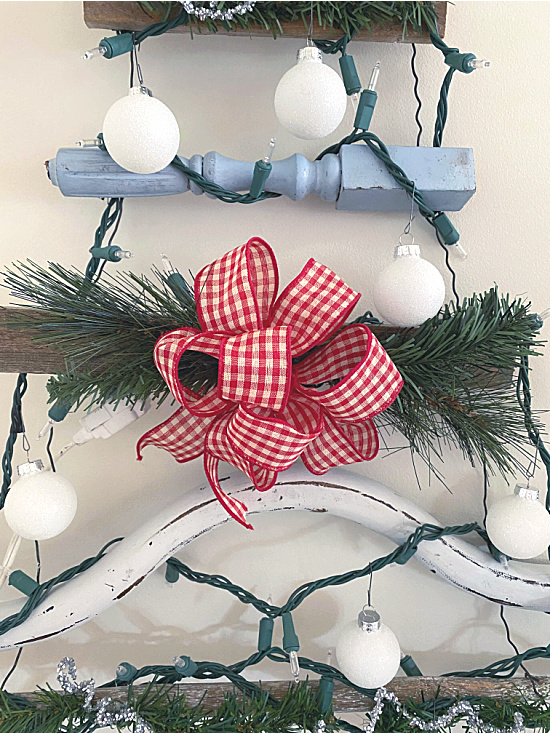 red and white gingham bow on tree