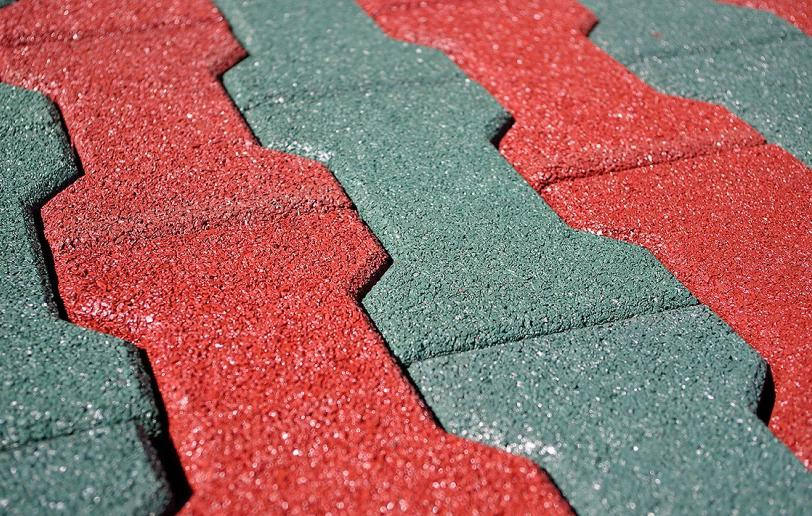 Manufacture of rubber tiles