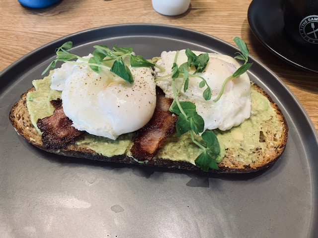 Bacon, poached eggs and smashed avocado on sourdough toast
