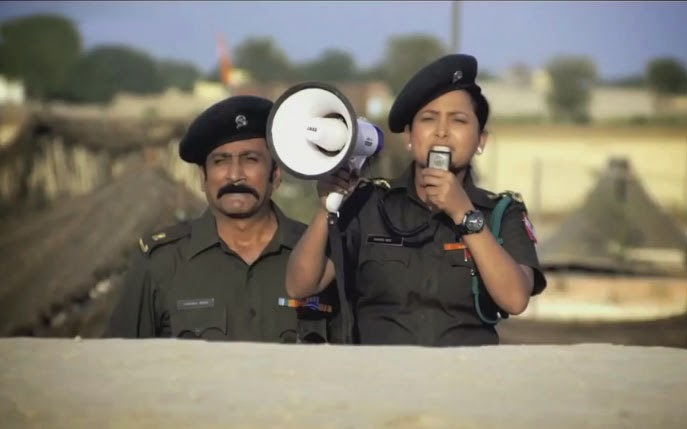 A female army officer at LoC, sends a warning on loud speaker, in Jai Ho! Democracy, Co-directed by Ranjit Kapoor and Bikramjeet Singh Bhullar