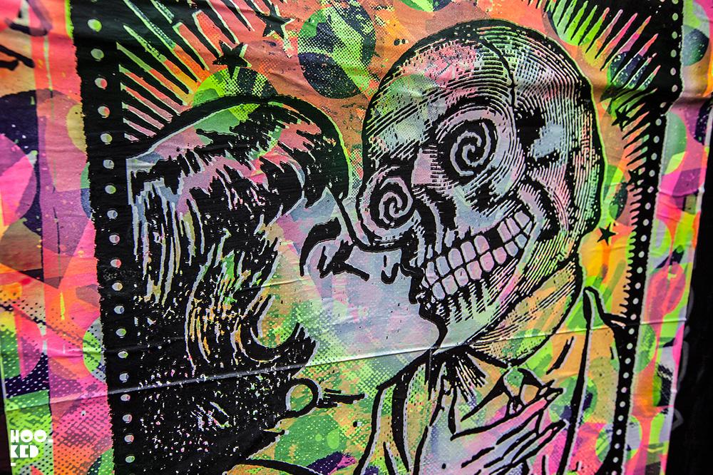 Women kissing a skeleton, Street Art Paste-ups in London by artist Zombiesqueegee