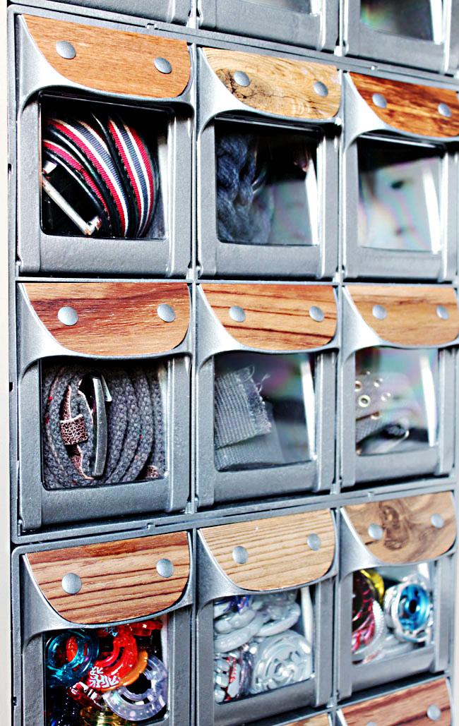 industrial looking storage bins inside wall storage