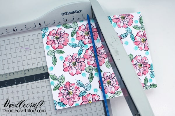 Cut floral paper with paper trimmer cutter.