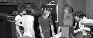 The Reggie Knighton Band collaborating with John Sebastian  on the animated film score for The Devil and Daniel Mouse circa 1979.  L to R Glenn Symmonds, Reggie Knighton, Clive Smith, Kurtis Teel and John Sebastian. Brian Ray was also present but not in this photo.