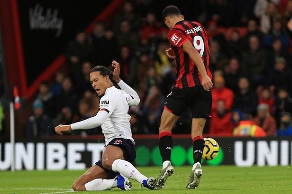 Virgil van Dijk of Liverpool tackles Dominick Solanke of Bournemouth