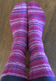 Socks knitted with DROPS Fabel Berry Dreams and has asymmetrical wedge toes and traditional heel flap