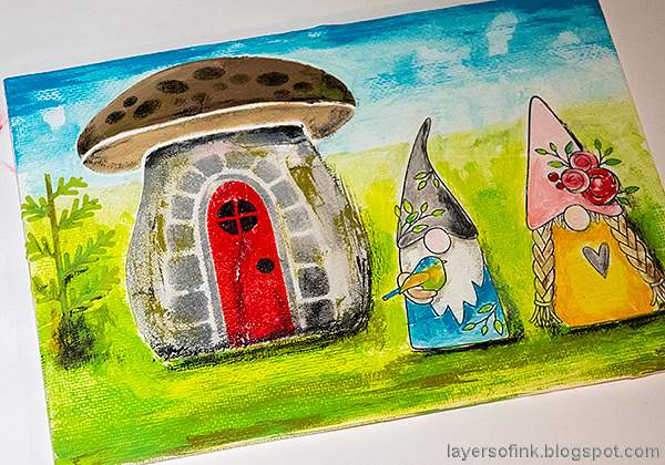Layers of ink - Gnome Home Mixed Media Canvas Tutorial by Anna-Karin Evaldsson. Add shading to the gnomes and their home.