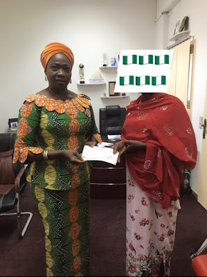 Selfless Woman Donates Salary (N500,000) To South Africa Returnees (Photo)