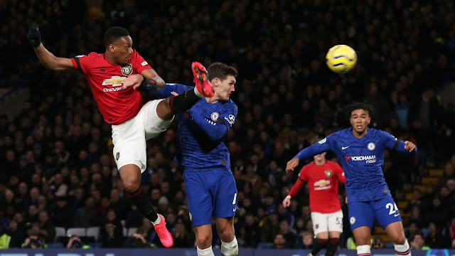 Martial scores a brilliant header to give Man United the lead at Stamford bridge in the premier league