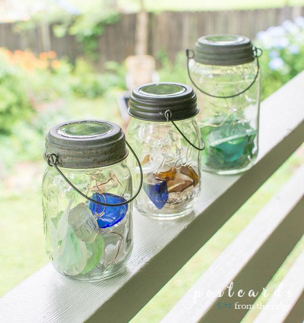 solar lanterns made with mason jars and creek glass