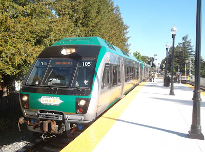 SMART Train No. 105, southbound to San Rafael, paused at outdoor boarding platform