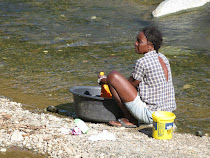 Eating, drinking, bathing and washing from the same stream (Haiti)