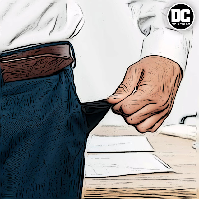 A man trying to get a nickel out of his pocket fabric