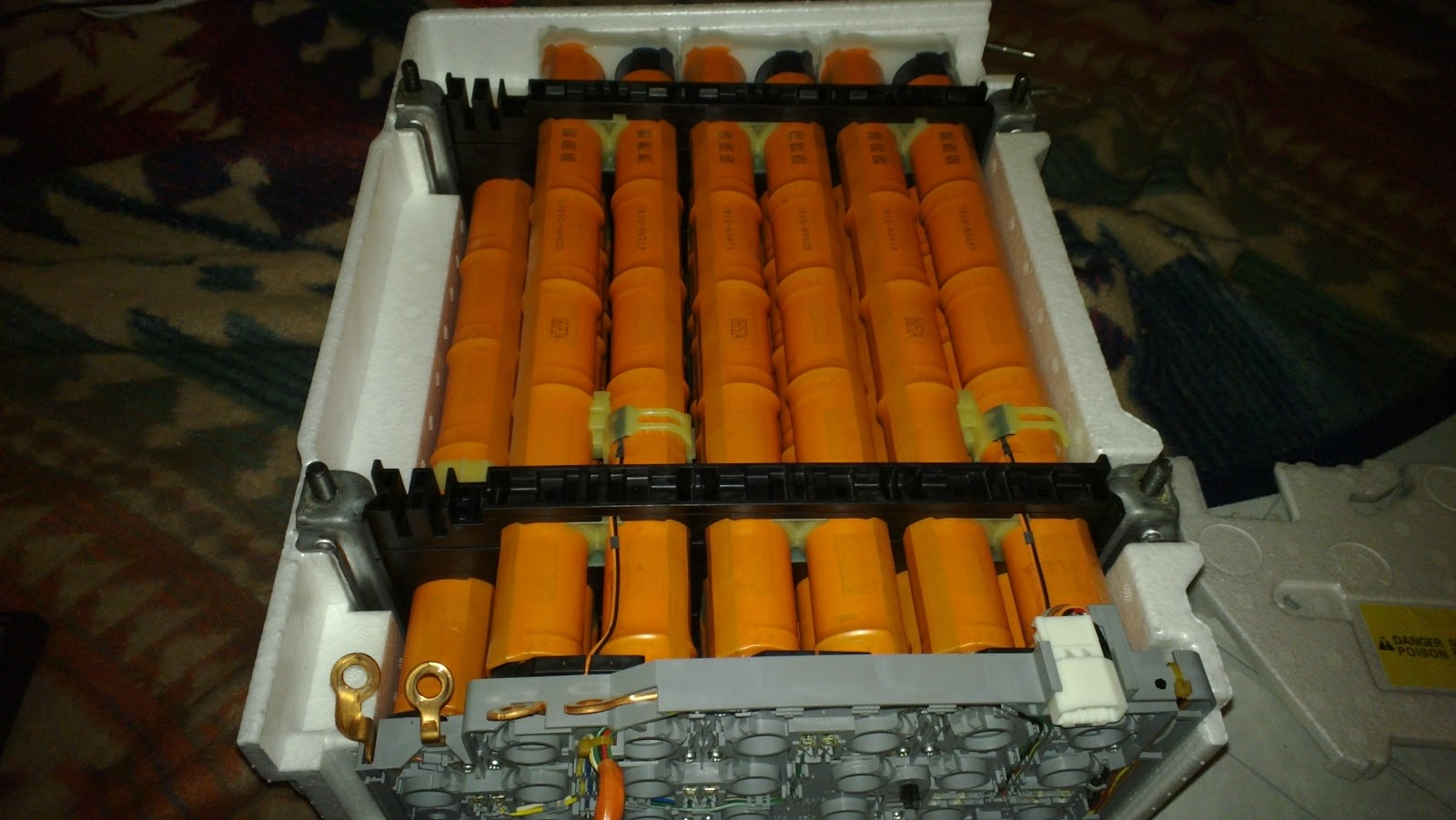 Another View Of The Battery Pack After Popping Out Steel Cover Two Sticks On Top And One Stick In Bottom Row Has A Thermistor Attached