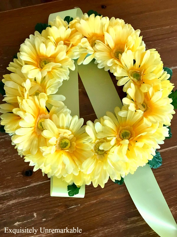 Yellow Floral Candle Ring on table