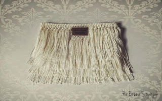 Fringed wallet in crochet