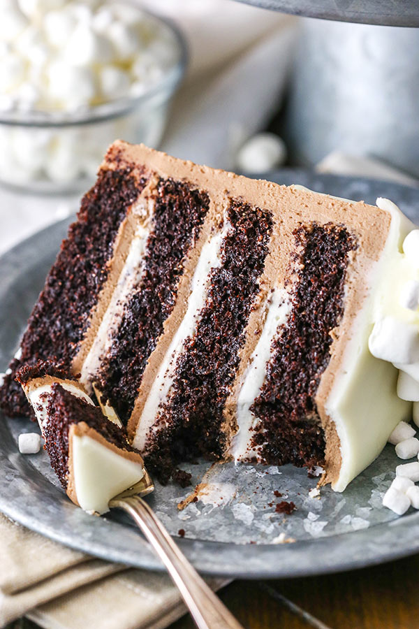 Hot Chocolate Cake - This Hot Chocolate Cake is a moist chocolate cake, hot chocolate buttercream frosting and marshmallow filling! The combination is wonderfully decadent and addicting!