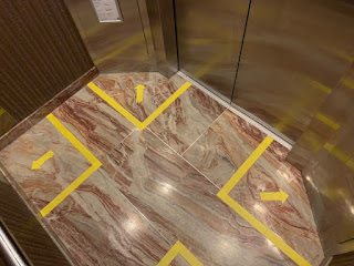 Safe distancing markets in Hilton elevator
