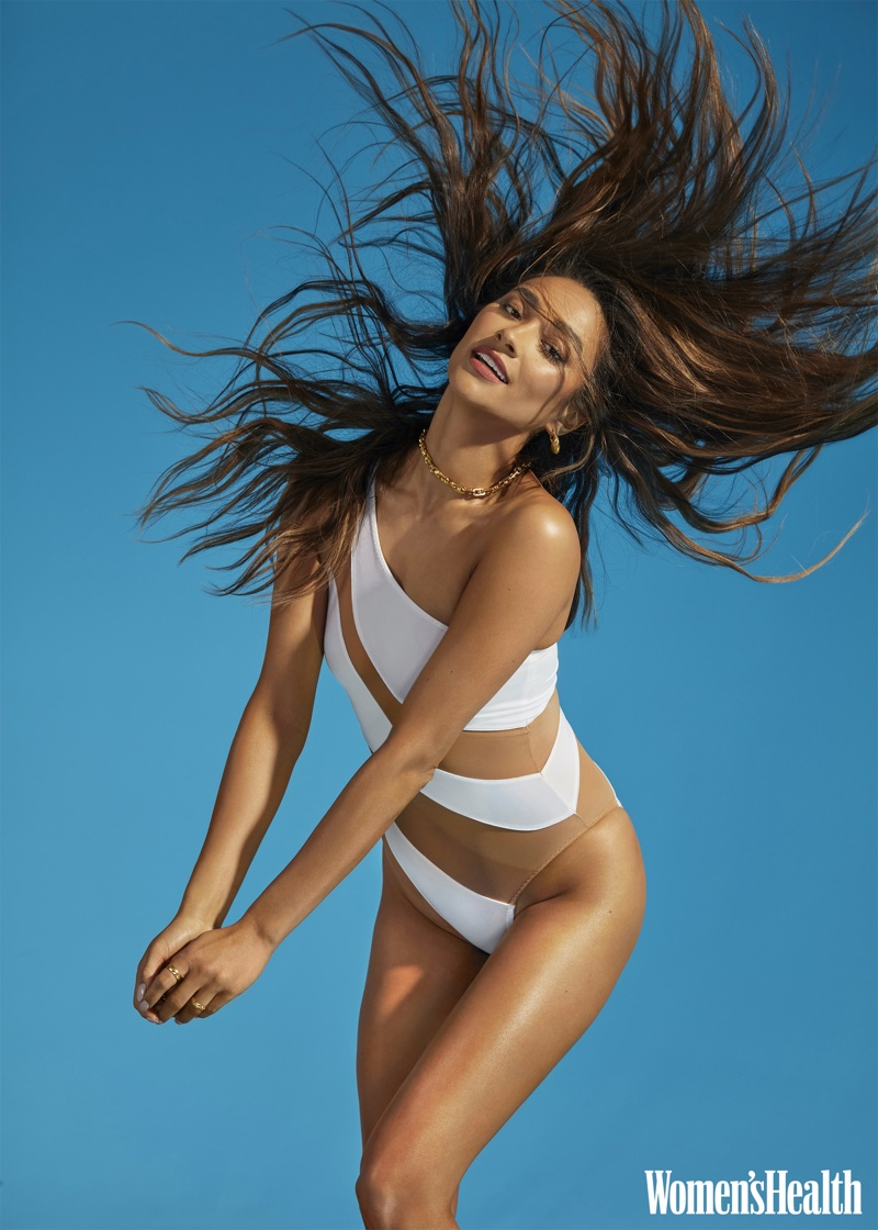 Actress Shay Mitchell wears one-shoulder swimsuit.
