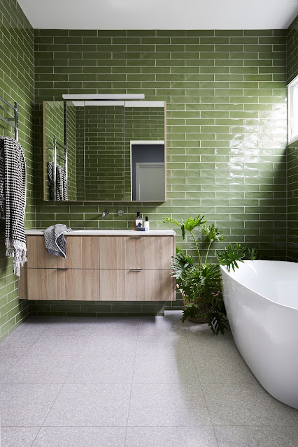 Bathroom clad with green glass subway tiles in a renovated Californian bungalow style house, Sandringham, suburban Melbourne, Australia. By Kate Walker Design.