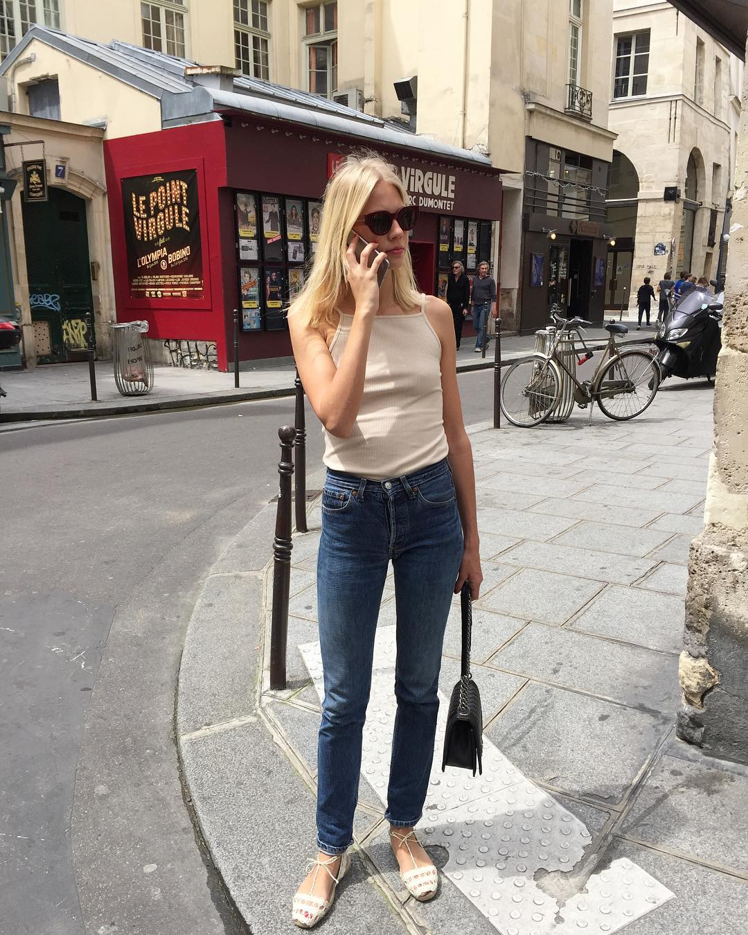 French-Girl Summer Outfit Idea — Emelie Thomsen in a tank top, jeans, and espadrilles