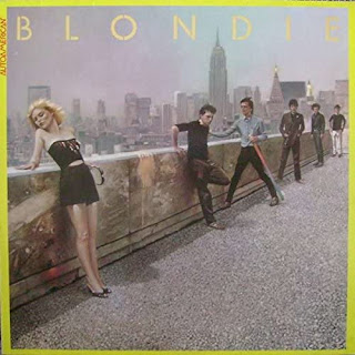 Blondie AutoAmerican cover - painting of band looking over a wall on a roof at a cityscape