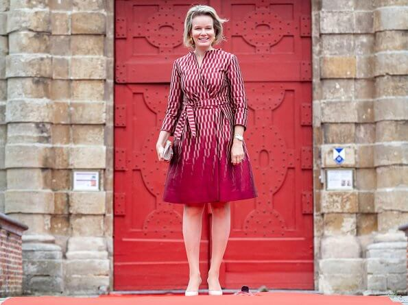 Queen Mathilde's outfit is by Belgian fashion house Natan. Queen Mathilde wore Natan dress from fall winter 2017-2018 collection