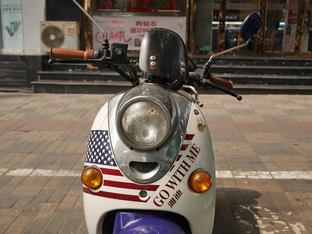 """Go With Me"" US flag design on front of motor scooter"