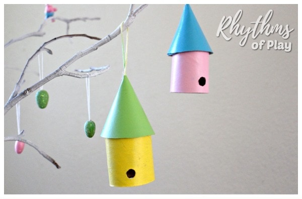 Toilet paper roll bird house ornaments hanging on a branch