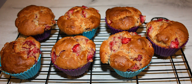 Cooked muffins cooling on a black wire rack. They look extremely tasty!