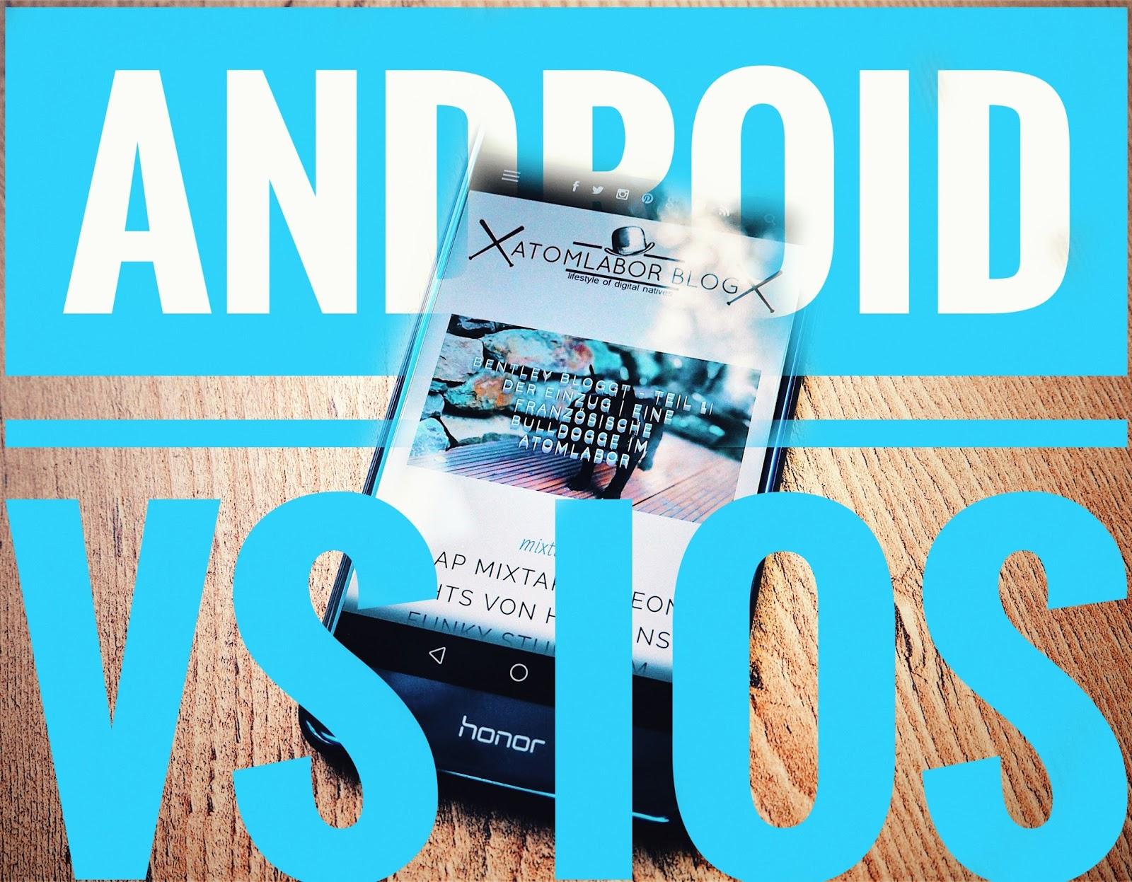 Schriftzug Android vs iOS über einem Android Smartphone von Honor welches auf einem Holzboden liegt