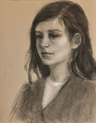 charcoal portrait sketch of a young woman on toned paper