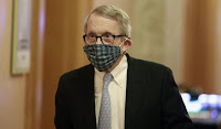 Gov. DeWine in what appears to be unsafe homemade cloth mask