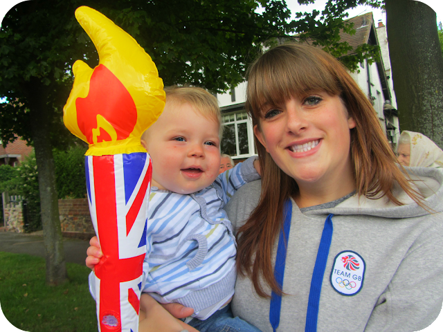 Holding the torch, watching olympic torch go by