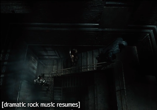 """A shot of Batman, Wonder Woman, and Cyborg climbing a flight of stairs in a building. The closed caption says """"[dramatic rock music resumes]."""""""