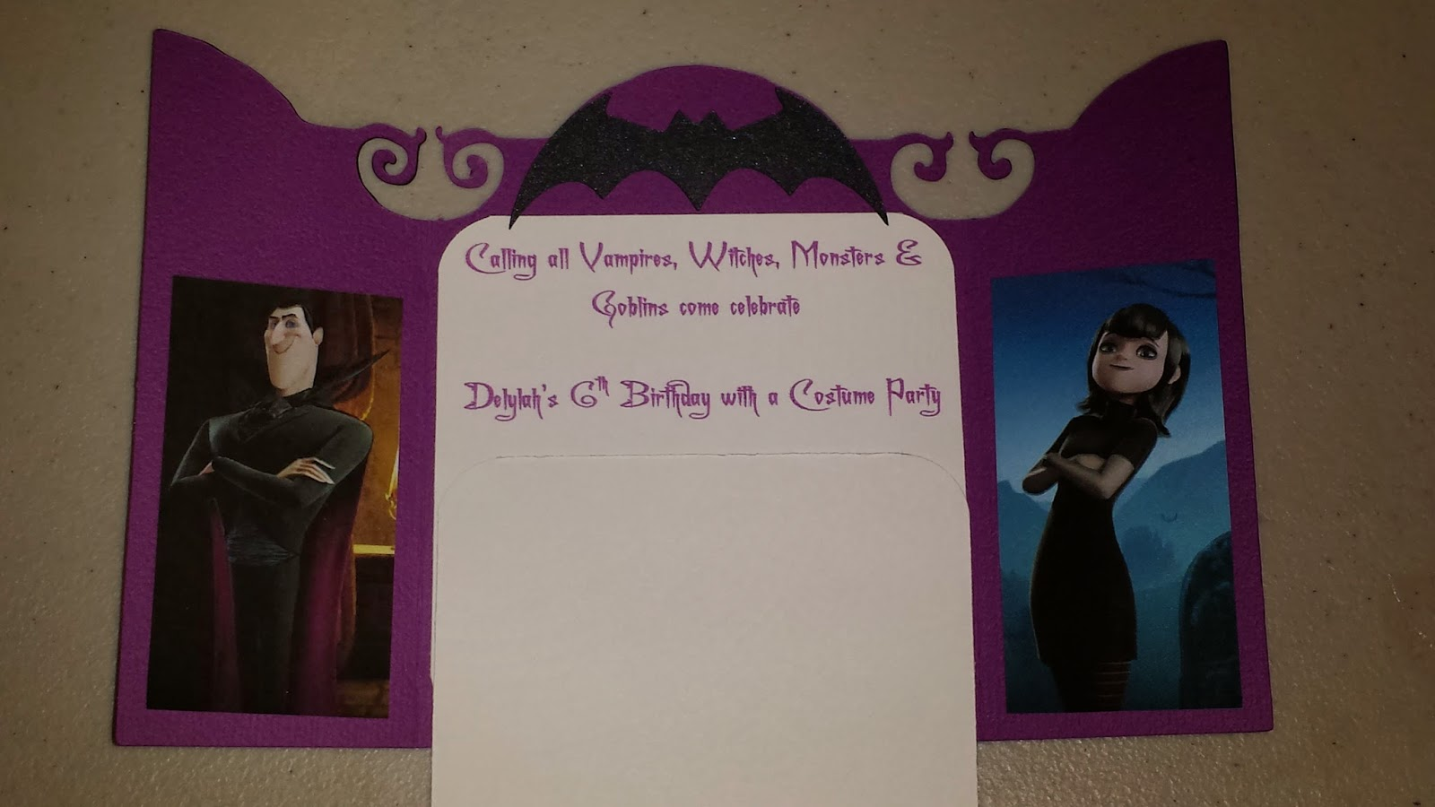 Inside of DIY Hotel Transylvania themed birthday party invitations