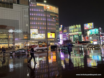 Shinjuku streets in rain in Tokyo, Japan