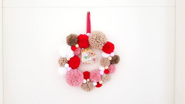 tutorial corona de navidad de pompones