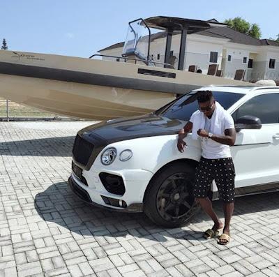 Obafemi Martins Poses With His Car