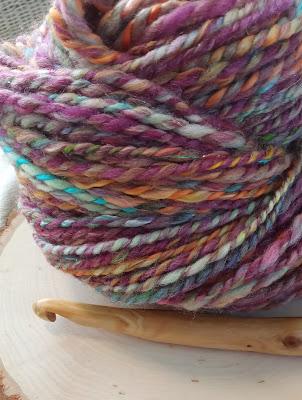 colorful handspun yarn and crochet hook
