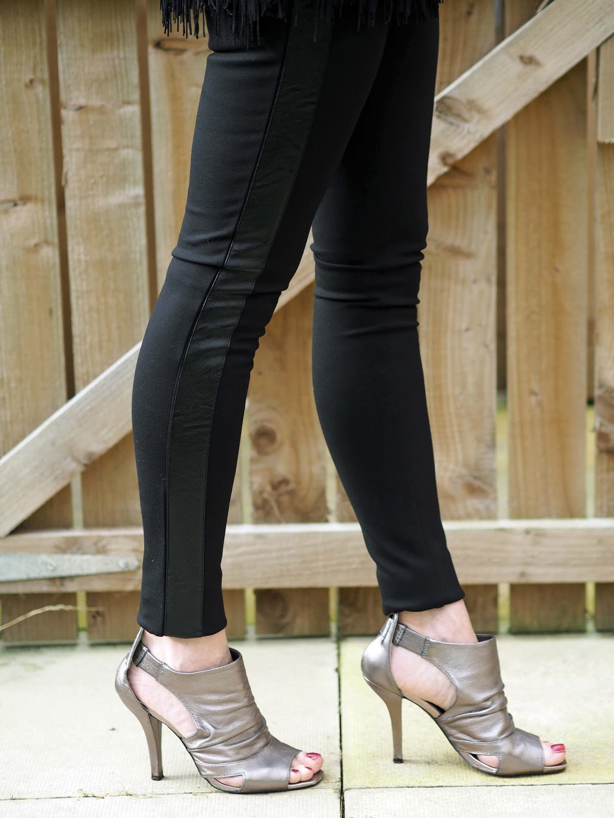 Hope narrow stretch trousers and tassel evening top with metallic clutch and metallic shoe boots