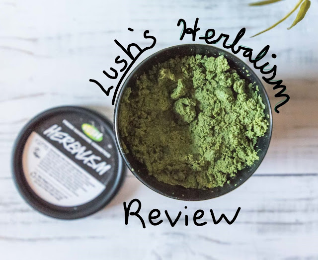 An image of a jar of Lush's Herbalism face cleanser, with the text Lush's Herbalism Review around the rim of the black container