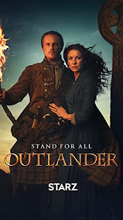 Outlander poster showing Caitriona Balfe and Sam Heughan