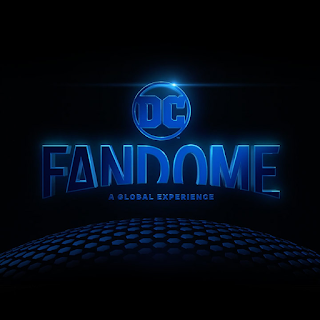 DC Fandome in blue curved writing on a black background