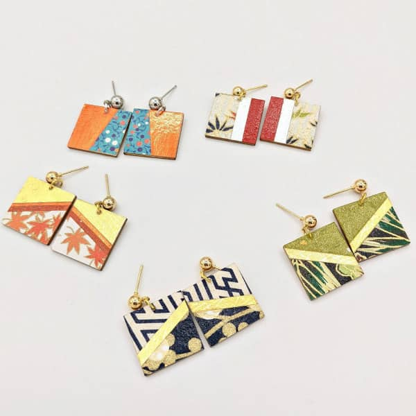 Square dangle earrings made of wood and origami paper