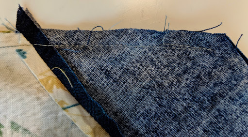 A line of sewing on Lone Star seams is backstitched at the end