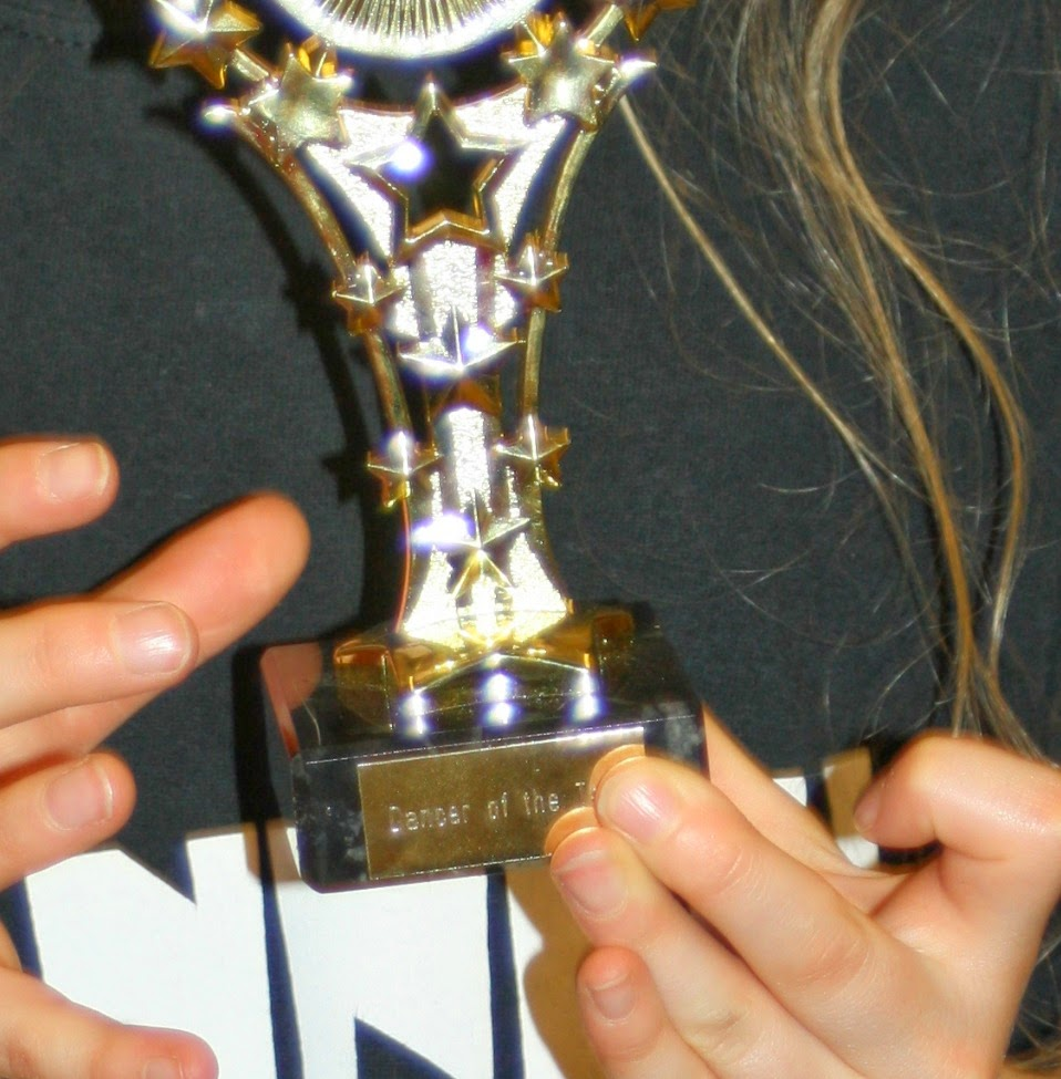 Daughter-dancing-trophy