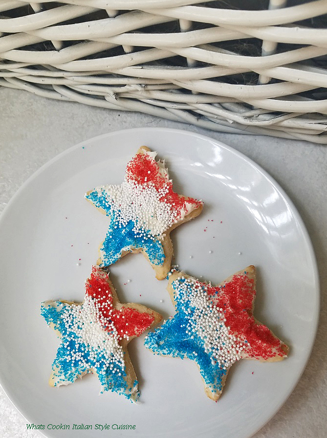 these are three patriotic cookies red white and blue colored sugar for the 4th of July called loft sugar cookies